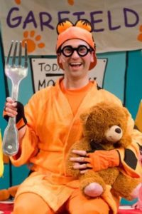 Steven Eubank (as Garfield) in The Coterie's musical production of, Garfield - The Musical With Cattitude, based on the characters created by Jim Davis, Book by Jim Davis and Michael J. Bobbitt, Music and Lyrics by John L. Cornelius II, and directed by Jerry Jay Cranford, on stage June 13 - August 6, 2017.